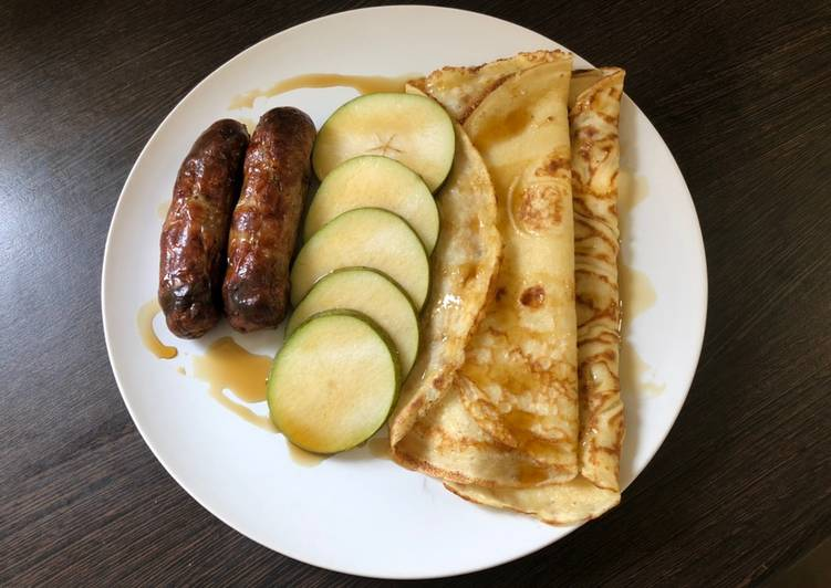 Brunch pancakes with sausage, pear and maple syrup