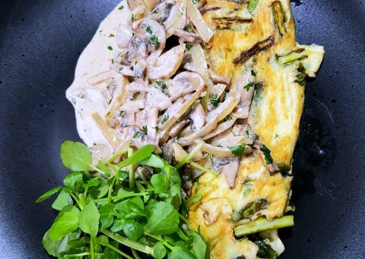 Asparagus omelette with a mushroom cream sauce