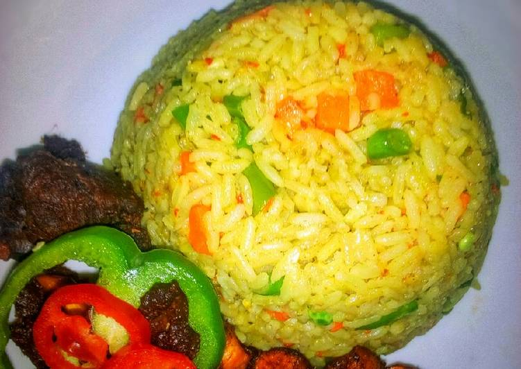 15 Minute Step-by-Step Guide to Make Royal Fried rice, with peppered goat meat and dodo