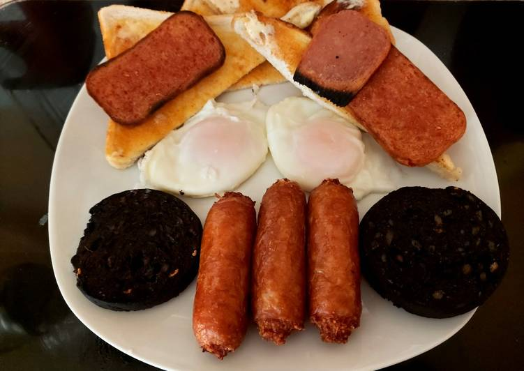 My filling Breakfast, Bacon Grill, Black pudding sausage + Eggs