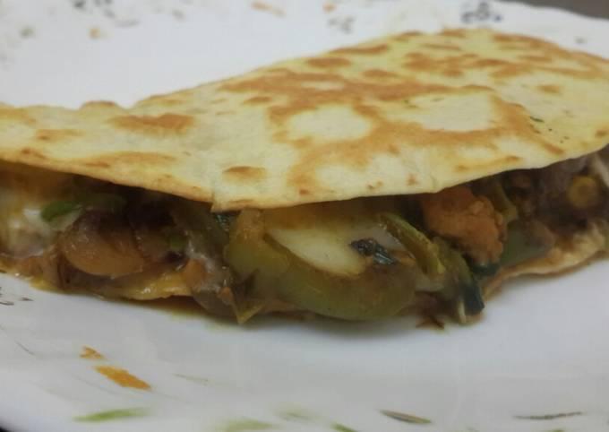 Cheese chicken and veggies tortilla wrap
