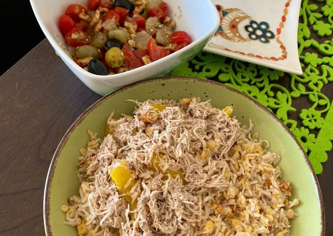 Healthy lunch Lentil with rice called Koshri and Chicken, salad