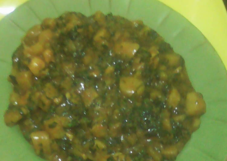 Unripe plantain porridge with scent leaf and curry leaf