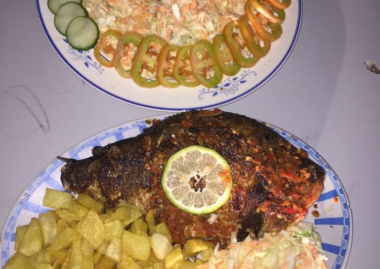 Grilled fish with french fries and coleslaw