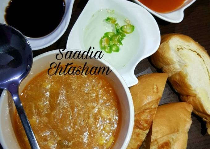 Hot and sour soup with cheesy bread stick
