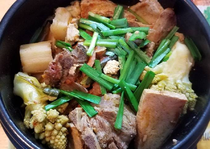 Pork neckbone cauliflower tofu stew