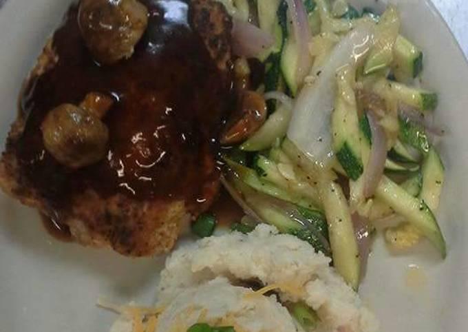 Stuffed pork chop topped with mushroom bordelaise sauce