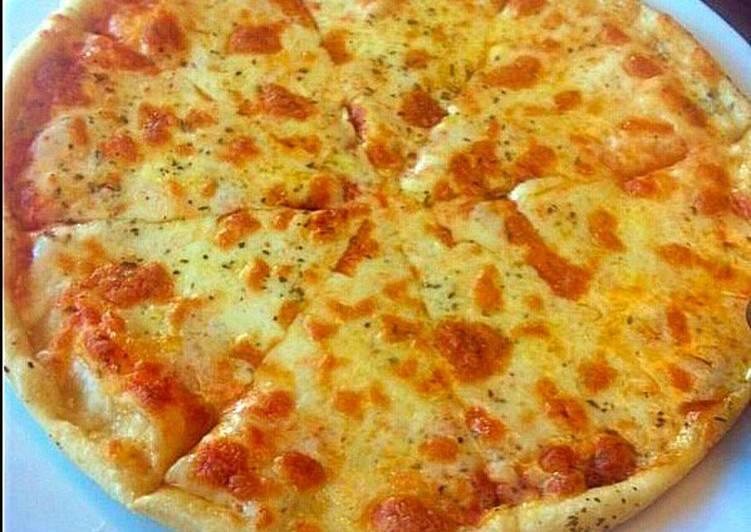 طريقة عمل بيتزا جبنة موزاريلا بنكهة الثوم بالصور من عاشقة تراب فلسطين كوكباد