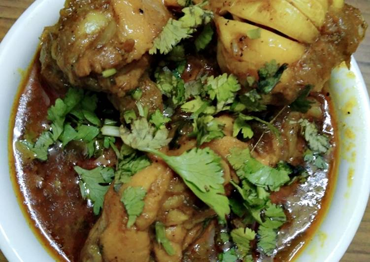 Chicken curry with whole garlic