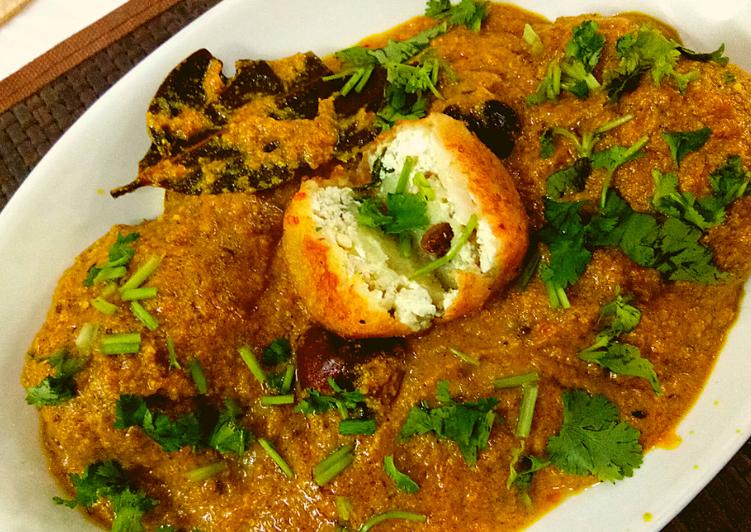 Aloo kofta with paneer stuffing in golden gravy