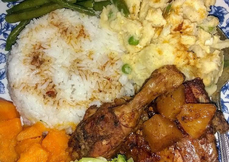 Homestyle chicken, mashed potatoes, candied yams and veggies