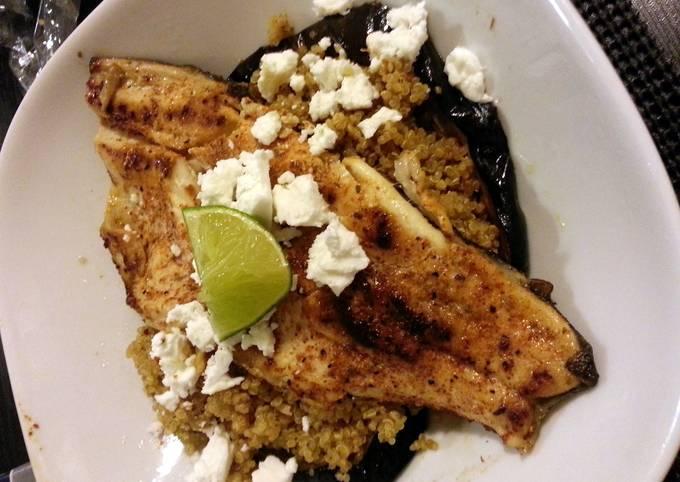 Pan seared trout served on quinoa chorizo  eggplant and French feta salad
