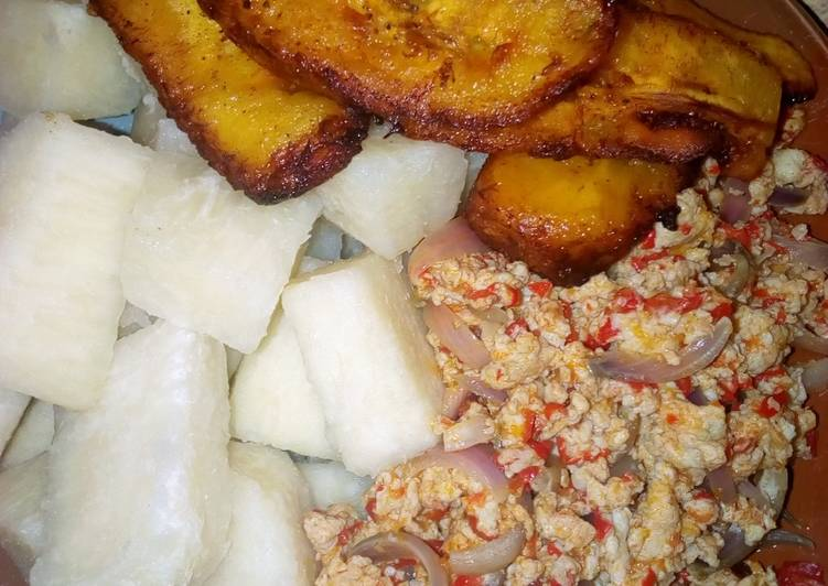 Boiled yam,egg sauce and plantain