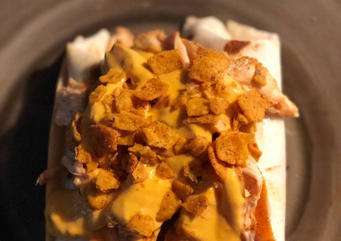 STEAK and SHREDDED CHICKEN BURRITOS WITH MELTED CHEESE/FRITOS: JAYS SMOTHERED BURRITO