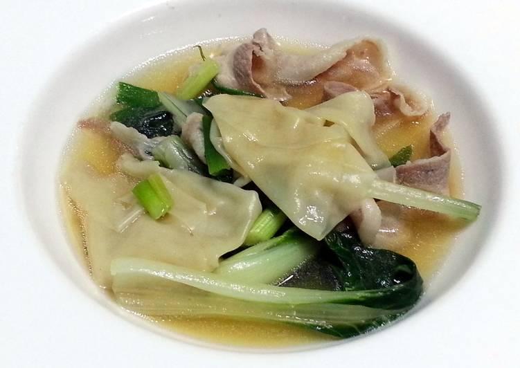 Bak Choy And Dumpling In Pork Broth