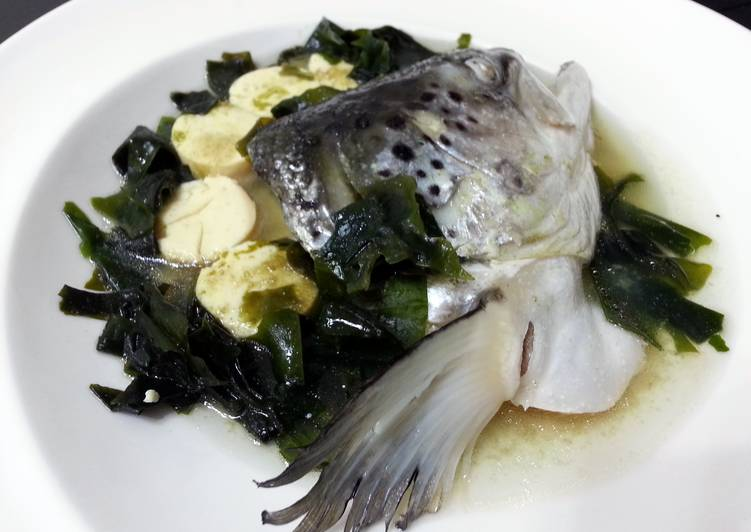 SALMON AND EGG TOFU IN WAKAME AND KELP BROTH