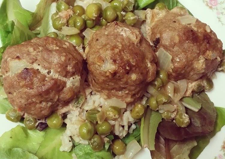 Turkey Meatballs w/ brown rice & peas over a bed of mixed greens