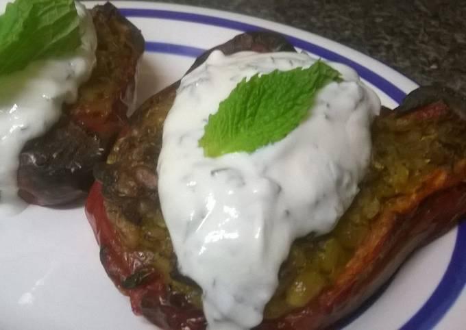 Rice stuffed peppers with mint yogurt sauce