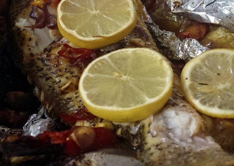 Baked red snapper with lemon and tomato