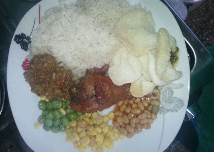 White Rice and Abykahuna Sauce with peppered saulted baked beans,sweet corn and green peas with driz