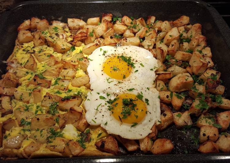 Roasted herb and garlic potatoes with eggs cooked two ways