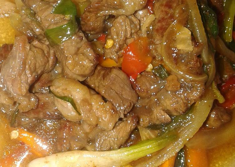 Nue pad prik namm man hoy or steak stir fry in oyster sauce.