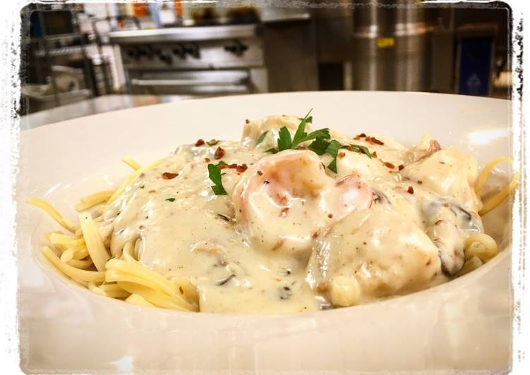 Shrimp and Scallops Shiitake, Mushroom, Bacon Cream Sauce over Pasta