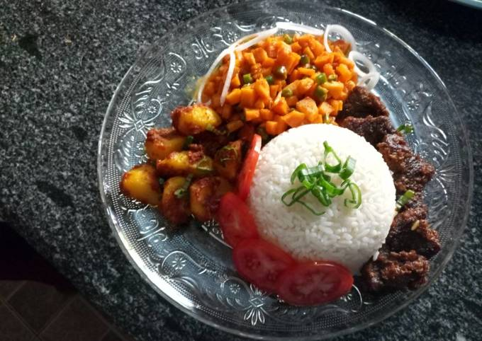 Carrot sauce, baked beef and potatoes and rice