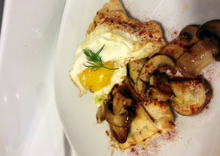 Living Greener for Good Health By Consuming Superfoods Greek Spanakopita topped w garlic fried egg