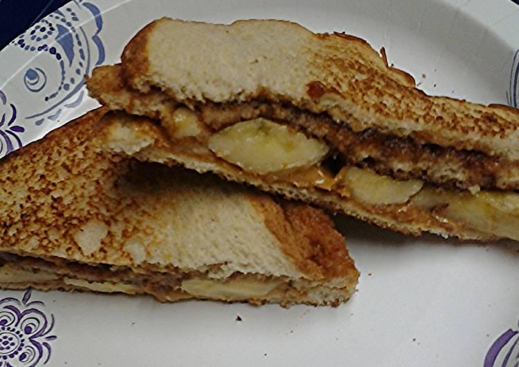 Apple butter peanut butter cashew butter banana sandwich