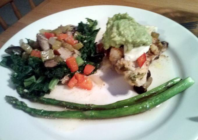 Garden Chicken with Marinated Fresh Mozeralla, Garlic Kale, butter seared Asparagus and Guacamole topping