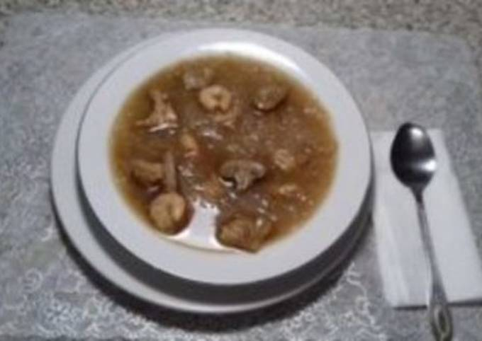 Chicken soup with Rice vermicelli, shrimp, and mushrooms