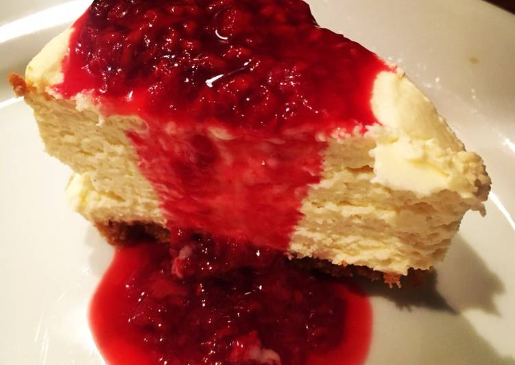 Simple White Chocolate Cheesecake with Raspberry Sauce