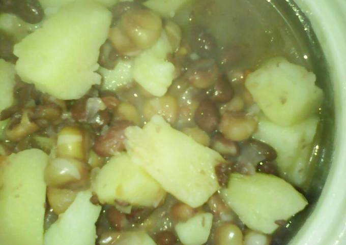 Stewed githeri cooked with potatoes