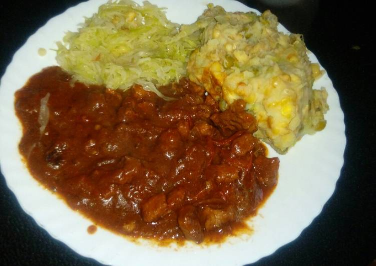Beef stew (garam masala) with steamed cabbage and mukimo