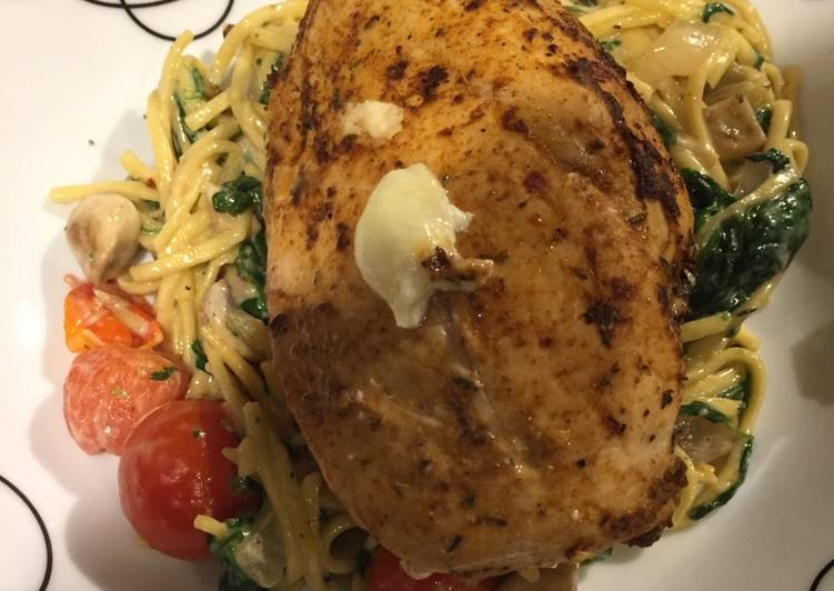 Easiest Way to Prepare Tasty Stuffed chicken on a bed of creamy cheesy noodles