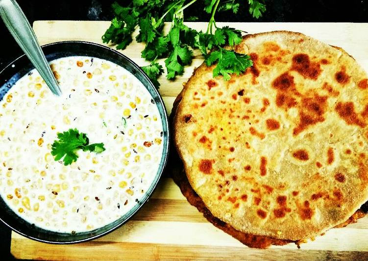 Alu paneer paratha serve with boondi raita
