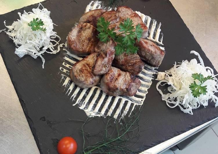 Swine steak on vulcano stones grill