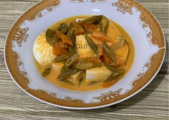 Lontong sayur (buncis wortel)