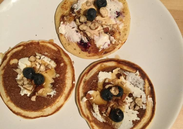 Low-fat pancakes with cream cheese, blueberries & hazelnuts