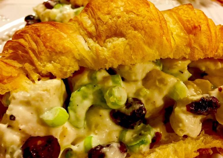 Cranberry Chicken Salad with Walnuts in a creamy Peppercorn Ranch Dressing on a Buttery Croissant