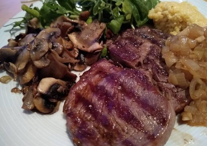 Ribeye Steak with Onion Gravy, Mushrooms & Fresh Greens