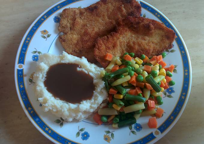 Breaded and tenderized chicken breast