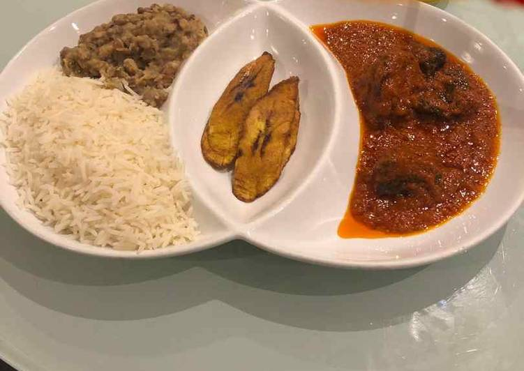 Rice and beans with plantain and stew