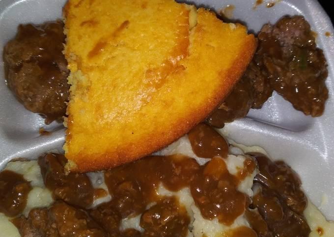 Homemade mashed potatoes w/ brown gravy hamburgers & cornbread!