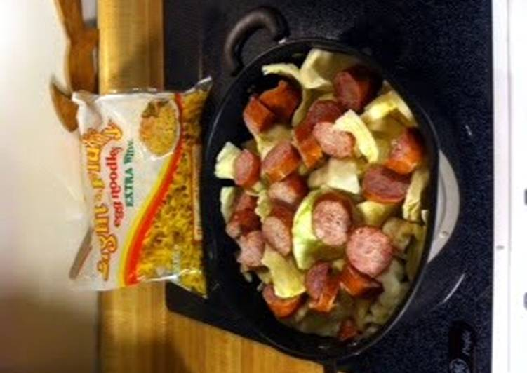 Fried cabbage and noodles with kielbasa