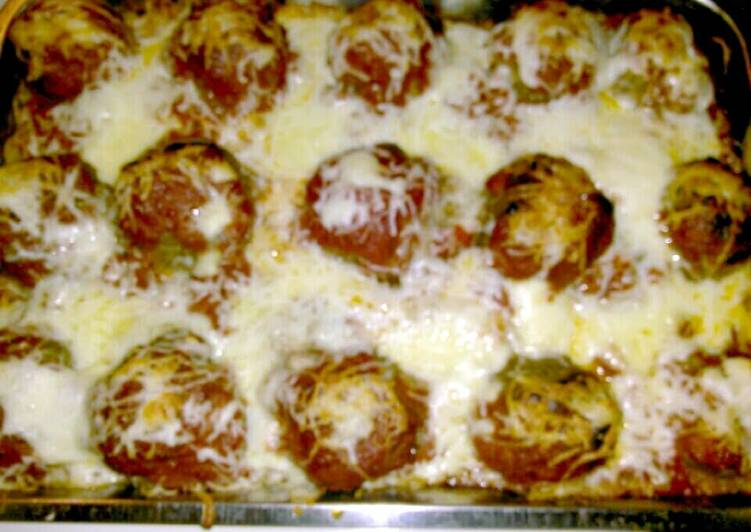 Vermont Cheddar Stuffed Meatballs with baked spaghetti.