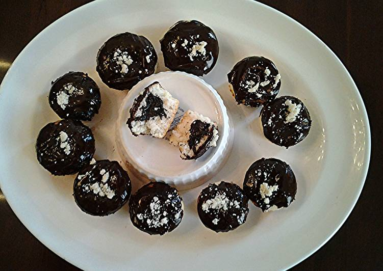 White Cupcakes with Chocolate Centers and Chocolate Glaze Icing