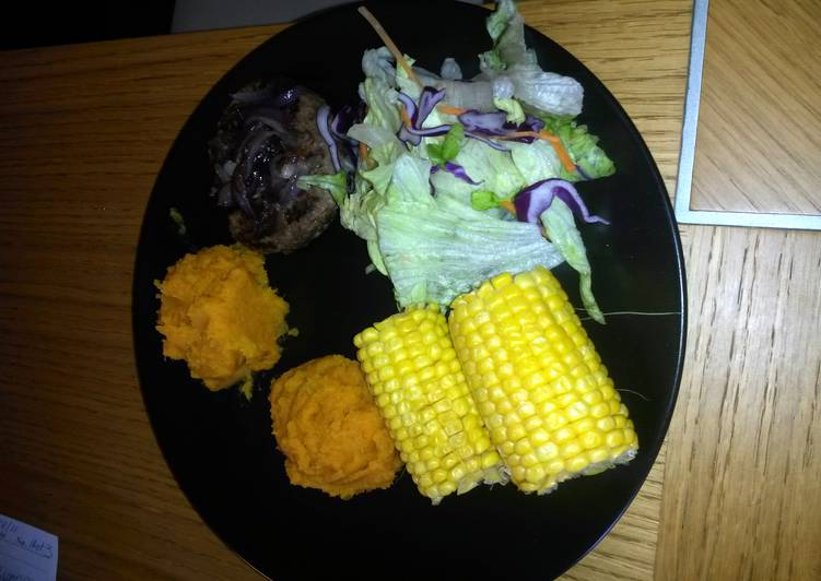 venison burger topped with sweet onions with aside of sweet potato mash with sweet corn