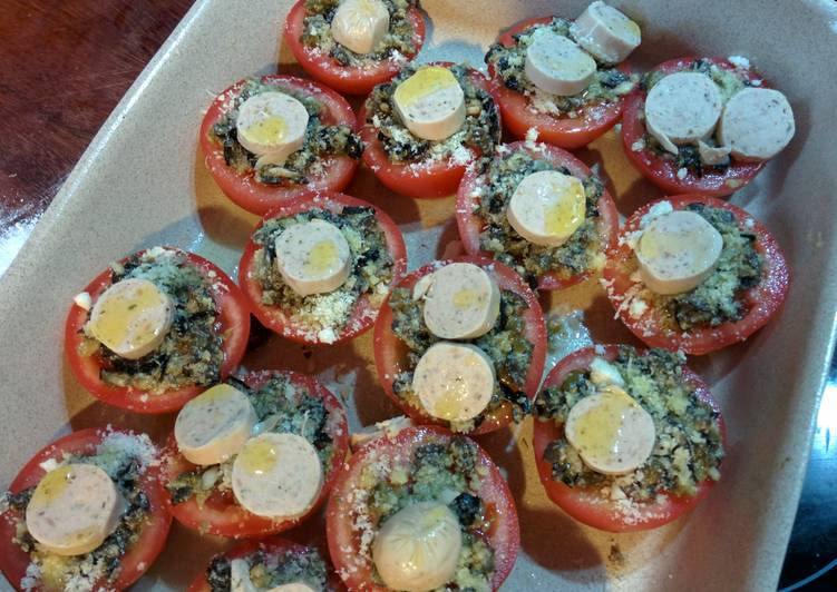 Roast tomatoes with olives, capers, cheese and sausage